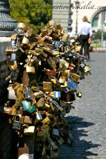 Love locks hanging on the bridge in Rome