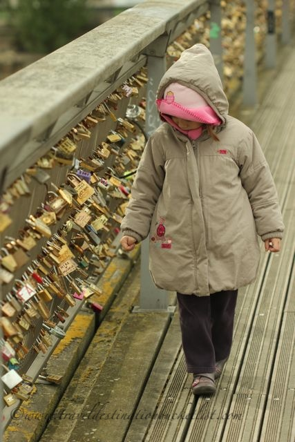 little girl looking at the love locks in Paris