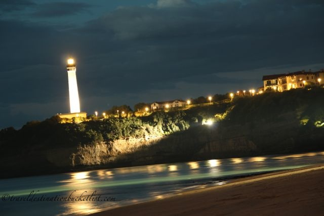Reflection on the beach as night falls on Biarritz, France