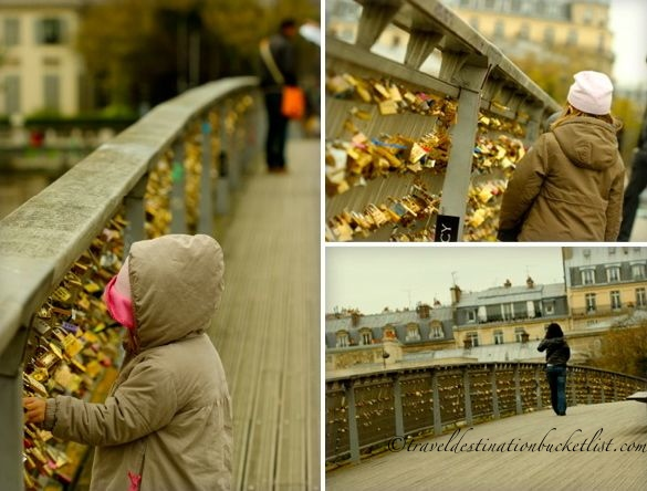 tourists looking at love locks in Paris